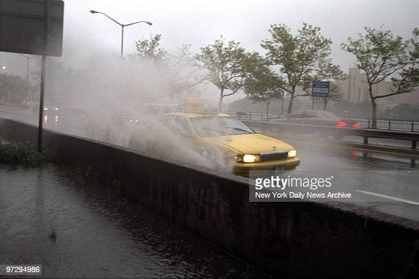 Cars swim on the FDR Drive at 106th St during Hurricane Floyd