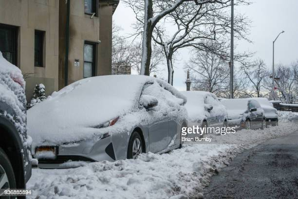 Cars trapped in snowbank on street