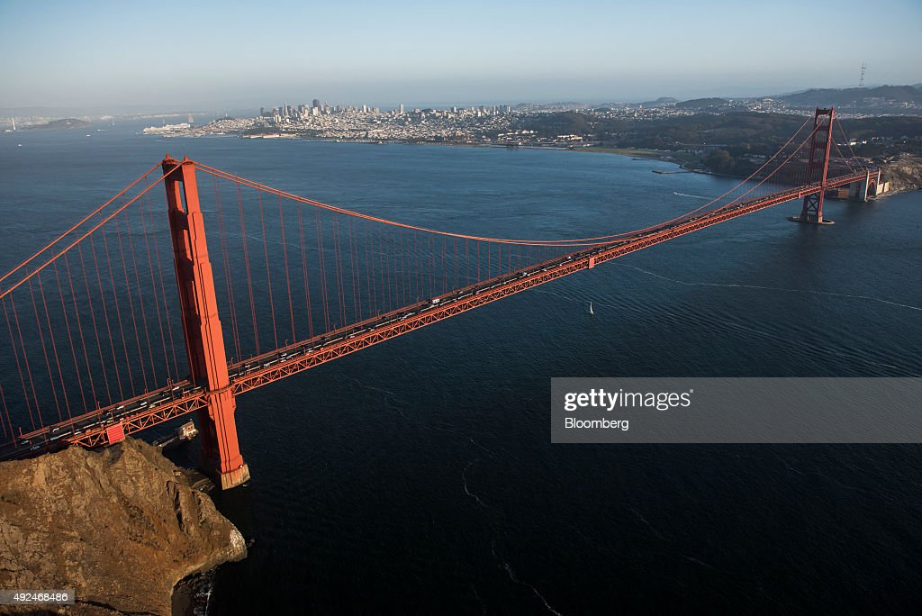 Cars travel across the Golden Gate Bridge in this aerial photograph taken above San Francisco, California, U.S., on Monday, Oct. 5, 2015. With tech workers flooding San Francisco, one-bedroom apartment rents have climbed to $3,500 a month, more than in any other U.S. city. Photographer: David Paul Morris/Bloomberg via Getty Images