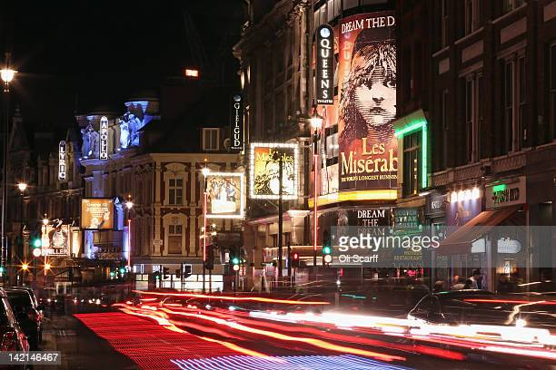 Cars travel along Shaftesbury Avenue past West End theatres at night on March 29, 2012 in London, England.