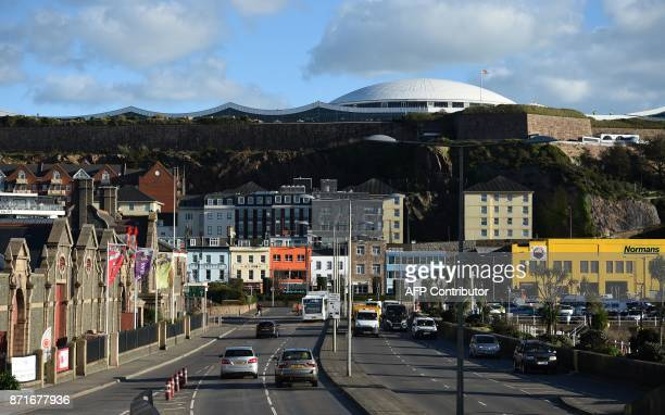 Cars travel by the seafront in St Helier on the British island of Jersey on November 8 2017 Jersey is a British Crown Dependency with a population of...