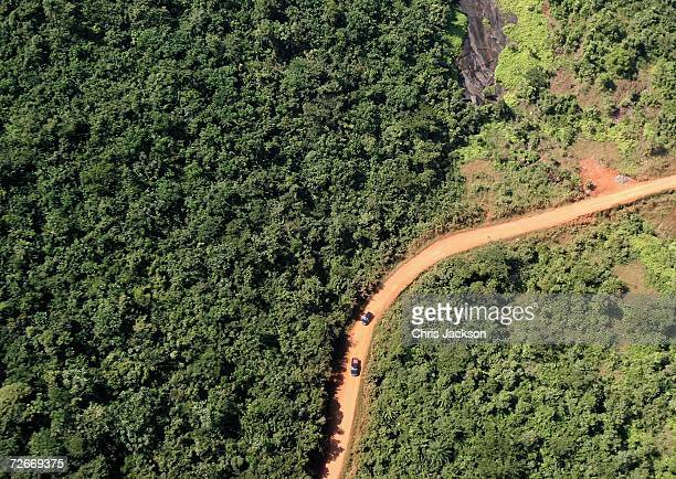 Cars travel down a track in the jungle just outside Freetown on November 28 2006 near Freetown Sierra Leone The country is trying to attract tourists...