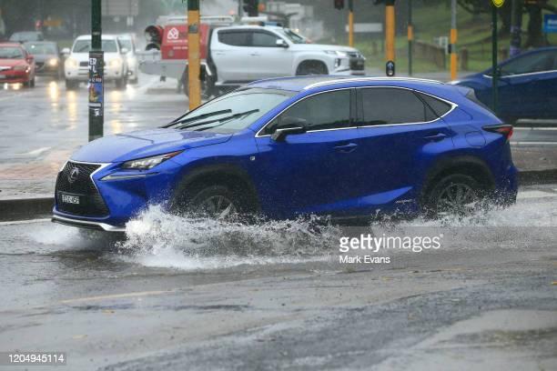 Cars travel through flooded roads on February 09 2020 in Sydney Australia The Bureau of Meteorology has forecast heavy rainfall across Sydney this...