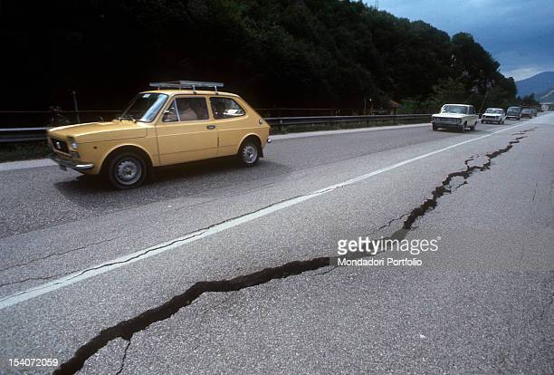 Cars traveling on a road affected by the earthquake FriuliVenezia Giulia May 1976