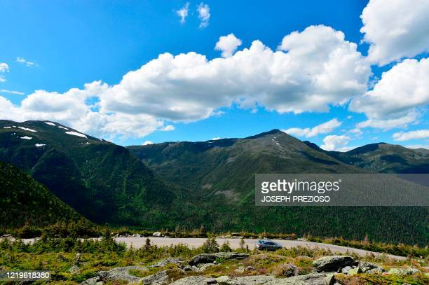 Cars traverses the auto road that leads to the top of Mount Washington, standing at an elevation of 6,288.2 ft in the Presidential Range of the White...