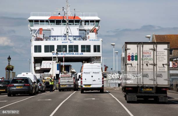 Cars, trucks and vans in line for the roll on roll off ferry to the mainland.