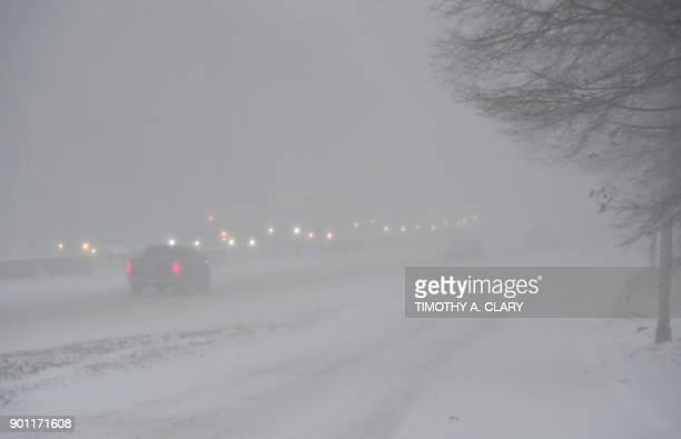 Cars try to make their way down Insterstate 95 near Greenwich Connecticut during a snow storm on January 4 2018 The US National Weather Service...