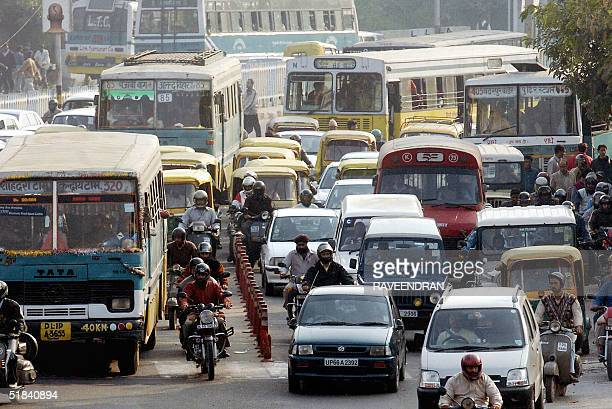 WITH 'INDIAPOLLUTIONTRANSPORTCOLOMBIA' Cars twowheelers trucks and buses form a massive traffic jam in a street in central New Delhi 09 December 2004...