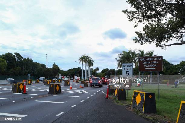 Cars wait in line to enter at the Nimitz Gate of Joint Base Pearl HarborHickam on December 4 2019 in Honolulu United States Early reports say a man...