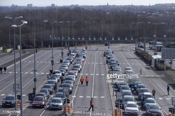 Cars wait to board the Eurotunnel train on March 8, 2019 in Folkestone, England. The Eurotunnel rail shuttle is a vital route for commercial traffic...