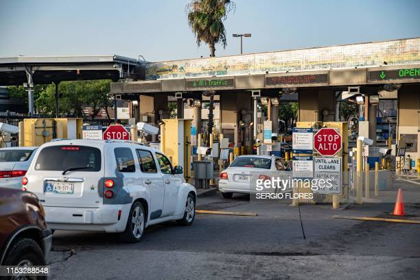 Cars wait to cross into Brownsville, Texas from Matamoros, Mexico on June 29, 2019. - Border cities like Matamoros, located just across the river...