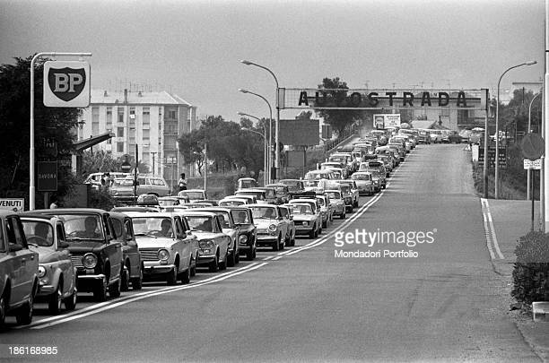 Cars waiting in a queue on the Autostrada dei Fiori On the roadside a British Petroleum sign Savona 15th August 1969