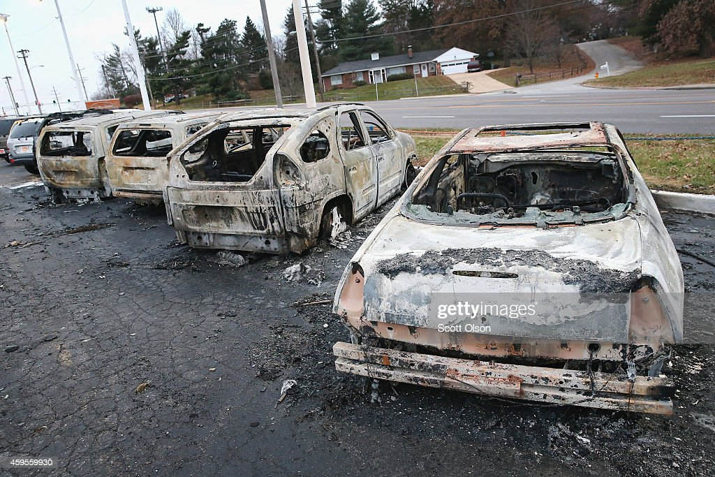 Cars which were set on fire when rioting erupted following the grand jury announcement in the Michael Brown case sit on a lot on November 25, 2014 in Dellword Missouri. Brown, an 18-year-old black man, was killed by Darren Wilson, a white Ferguson police officer, on August 9. At least 12 buildings were torched and more than 50 people were arrested during the night-long rioting.