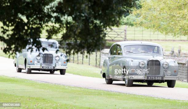 Cars with the page boys and flower girls arrive at the wedding Of Pippa Middleton and James Matthews at St Mark's Church on May 20 2017 in Englefield...