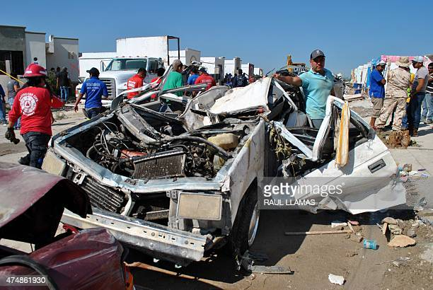 Cars wrecked by the passage of a tornado in Ciudad Acuna Mexico on May 25 2015 A tornado ripped into a town in northern Mexico on Monday killing at...