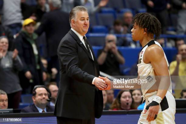 Carsen Edwards is congratulated by his head coach Matt Painter of the Purdue Boilermakers against the Villanova Wildcats in the second half during...