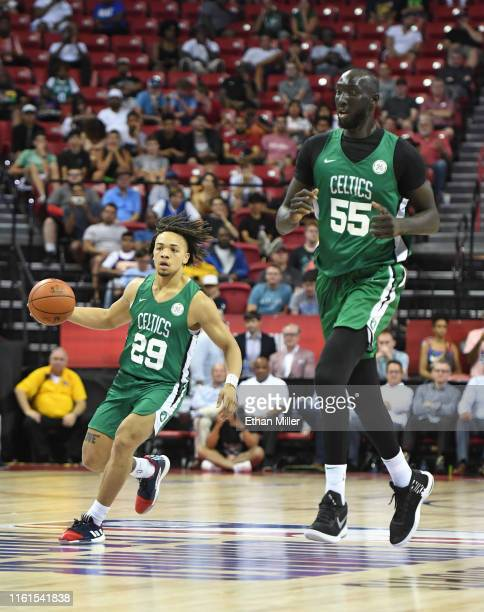 Carsen Edwards of the Boston Celtics brings the ball up the court alongside teammate Tacko Fall during a game against the Memphis Grizzlies during...