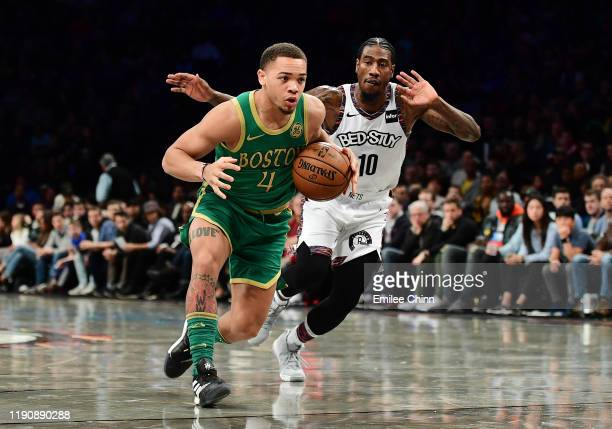 Carsen Edwards of the Boston Celtics drives past Iman Shumpert of the Brooklyn Nets during the first half of their game at Barclays Center on...