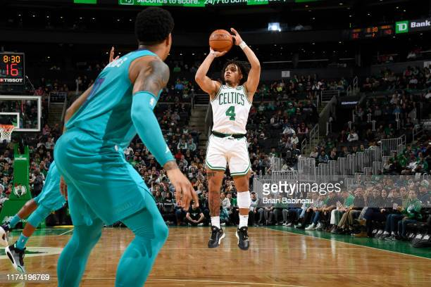 Carsen Edwards of the Boston Celtics shoots three point basket against the Charlotte Hornets on October 6 2019 at the TD Garden in Boston...