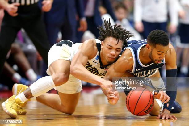 Carsen Edwards of the Purdue Boilermakers and Phil Booth of the Villanova Wildcats battle for the ball in the first half during the second round of...
