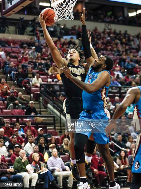 Carsen Edwards of the Purdue Boilermakers attacks the basket over PJ Savoy of the Florida State Seminoles during the ACCBig Ten Challenge at Donald L...