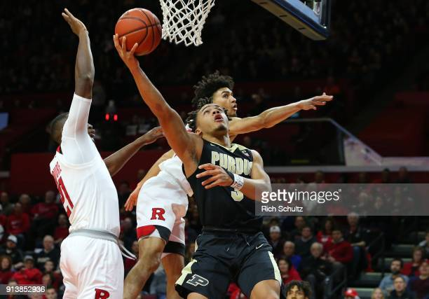 Carsen Edwards of the Purdue Boilermakers attempts a layup as Mamadou Doucoure and Geo Baker of the Rutgers Scarlet Knights defends during the first...