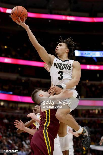 Carsen Edwards of the Purdue Boilermakers attempts a shot over Brock Stull of the Minnesota Golden Gophers in the second half during the...