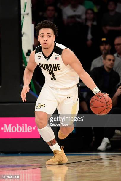 Carsen Edwards of the Purdue Boilermakers brings the ball up court against the Michigan Wolverines during the championship game of the Big Ten...