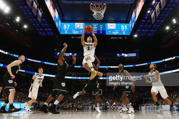 Carsen Edwards of the Purdue Boilermakers drives to the basket during the second half against the Butler Bulldogs in the second round of the 2018...