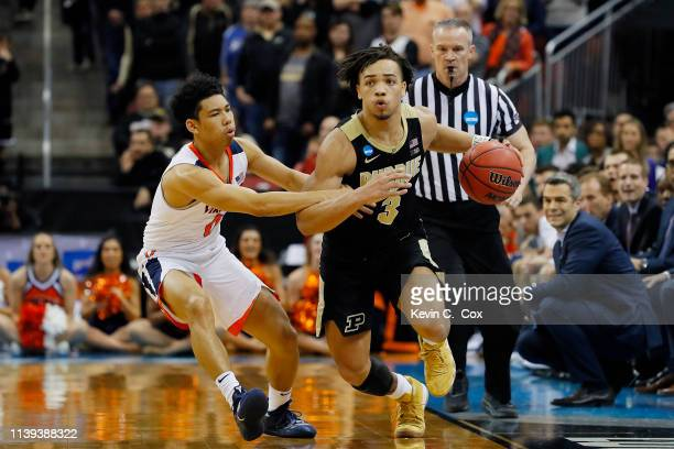 Carsen Edwards of the Purdue Boilermakers drives up the court against Kihei Clark of the Virginia Cavaliers during overtime of the 2019 NCAA Men's...