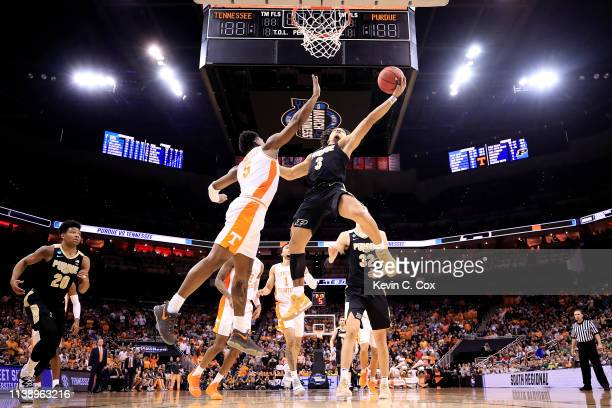 Carsen Edwards of the Purdue Boilermakers goes up for a layup against Admiral Schofield of the Tennessee Volunteers during overtime of the 2019 NCAA...