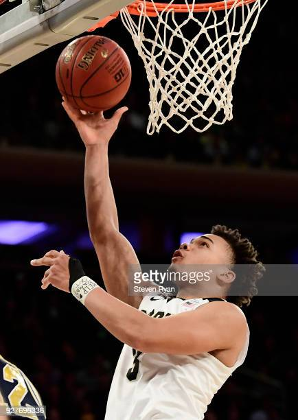 Carsen Edwards of the Purdue Boilermakers goes up for a layup against the Michigan Wolverines during the championship game of the Big Ten Basketball...