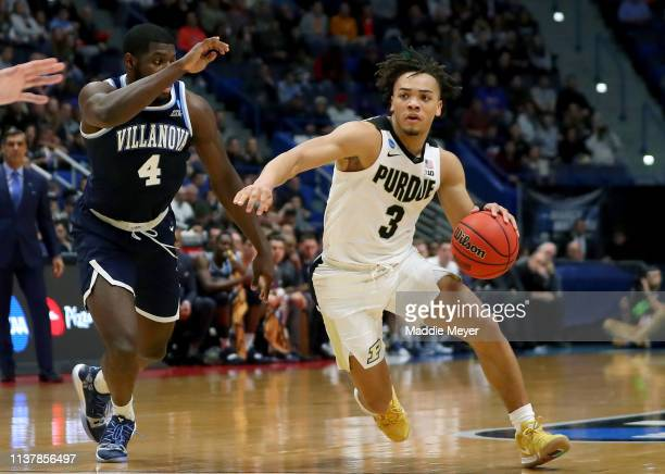 Carsen Edwards of the Purdue Boilermakers is defended by Eric Paschall of the Villanova Wildcats in the second half during the second round of the...