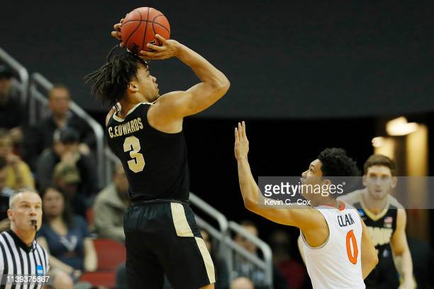 Carsen Edwards of the Purdue Boilermakers shoots a three pointer over Kihei Clark of the Virginia Cavaliers during the first half of the 2019 NCAA...
