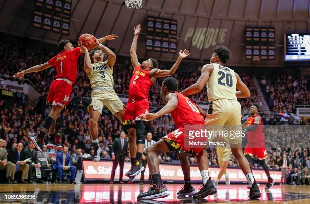Carsen Edwards of the Purdue Boilermakers shoots the ball against Anthony Cowan Jr. #1 and Aaron Wiggins of the Maryland Terrapins at Mackey Arena on...