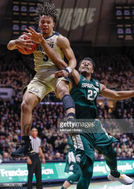 Carsen Edwards of the Purdue Boilermakers snags a rebound against Xavier Tillman of the Michigan State Spartans during the first half at Mackey Arena...