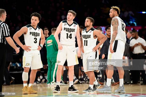 Carsen Edwards Ryan Cline PJ Thompson and Vincent Edwards of the Purdue Boilermakers huddle against the Penn State Nittany Lions during the...