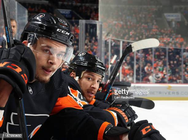 Carsen Twarynski and Chris Stewart of the Philadelphia Flyers look on from their bench against the Dallas Stars on October 19, 2019 at the Wells...