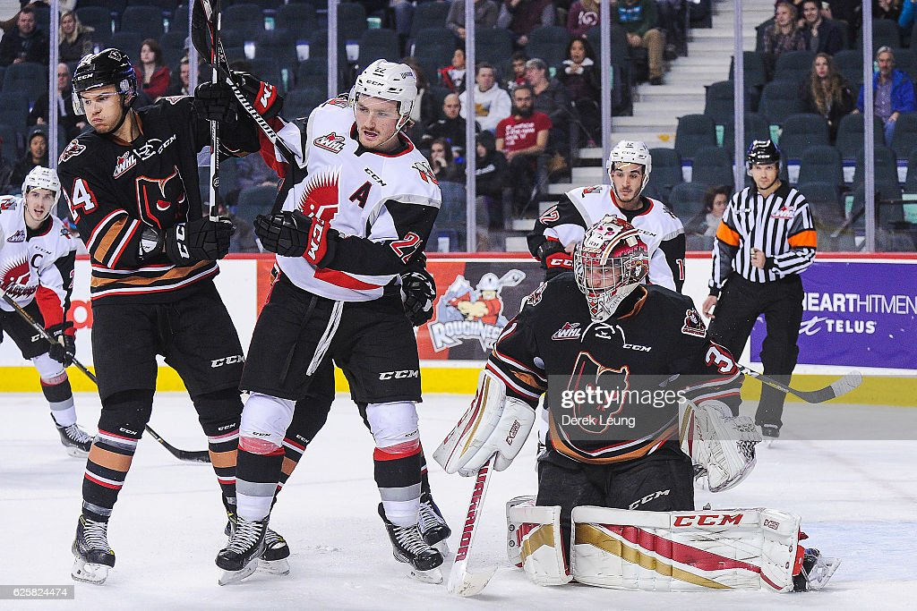 Carsen Twarynski #24 (L) and Cody Porter #31 of the Calgary Hitmen defend net against Noah Gregor #22 of the Moose Jaw Warriors during a WHL game at Scotiabank Saddledome on November 25, 2016 in Calgary, Alberta, Canada.