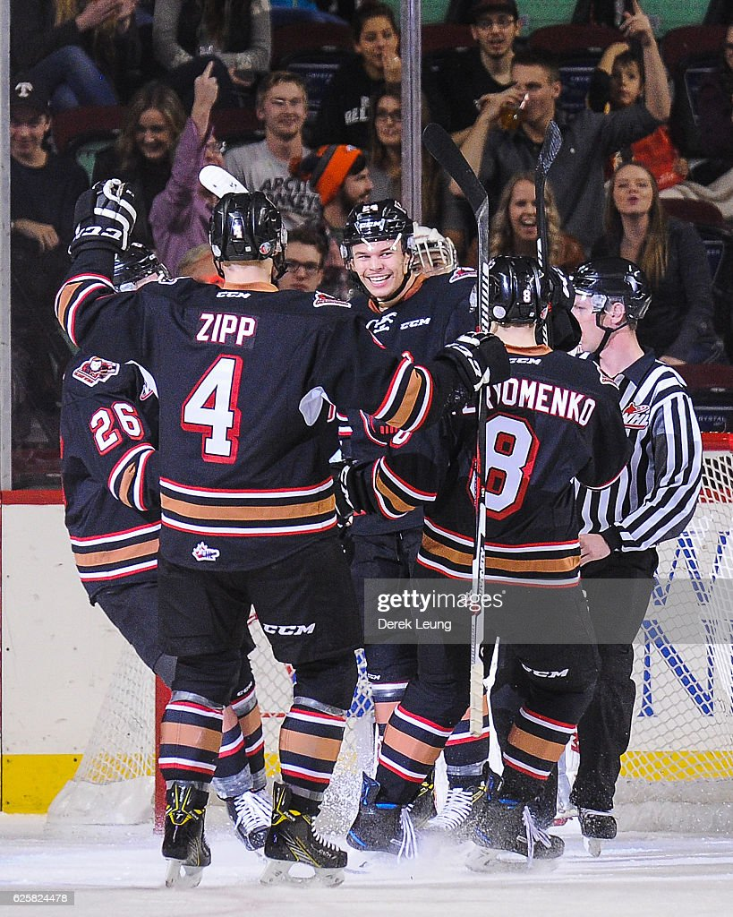 Carsen Twarynski #24 (C) of the Calgary Hitmen celebrates with his team after scoring against the Moose Jaw Warriors during a WHL game at Scotiabank Saddledome on November 25, 2016 in Calgary, Alberta, Canada.