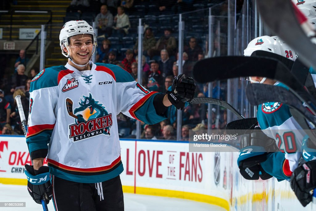 Carsen Twarynski #18 of the Kelowna Rockets skates to the bench to fist bump teammates after scoring a goal against the Medicine Hat Tigers at Prospera Place on January 30, 2018 in Kelowna, Canada.