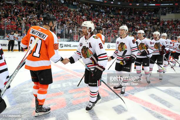Carsen Twarynski of the Philadelphia Flyers and Duncan Keith of the Chicago Blackhawks shake hands after the Flyers defeated the Blackhawks 4-3...