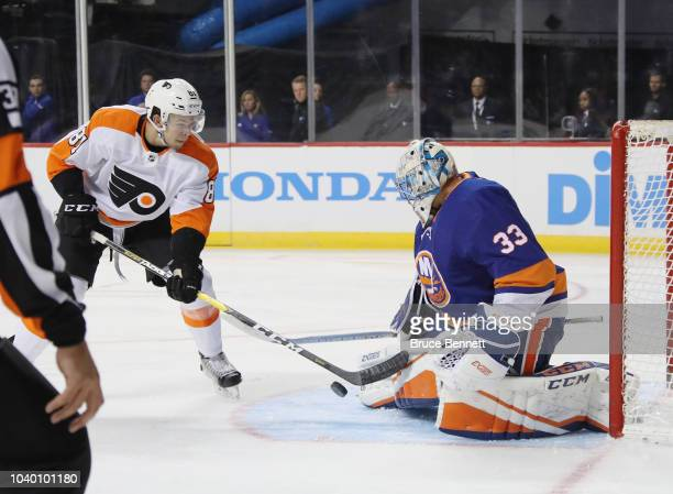 Carsen Twarynski of the Philadelphia Flyers is stopped by Christopher Gibson of the New York Islanders during the second period at the Barclays...