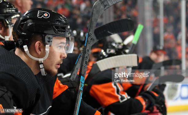 Carsen Twarynski of the Philadelphia Flyers looks on from the bench against the Dallas Stars on October 19, 2019 at the Wells Fargo Center in...