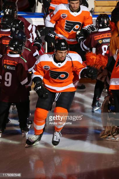 Carsen Twarynski of the Philadelphia Flyers steps onto the ice during player introductions prior to playing against the Chicago Blackhawks during the...