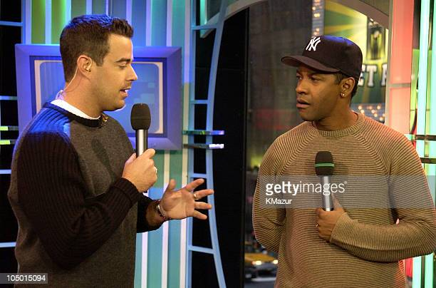 Carson Daly and Denzel Washington during Kylie Minogue and Denzel Washington Visit MTV's TRL December 18 2002 at MTV Times Square Studios in New York...