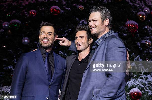 Carson Daly singers Adam Levine and Blake Shelton attend the Universal CityWalk Tree Lighting Ceremony at Universal CityWalk on November 24 2014 in...