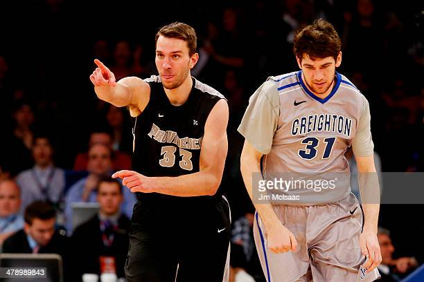Carson Desrosiers of the Providence Friars and Will Artino of the Creighton Bluejays react during the Championship game of the 2014 Men's Big East...