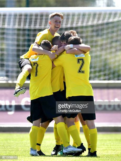Carson Elliott of County Antrim is mobbed by teammates after scoring the opening goal during the NI Super Cup junior section game between Southampton...