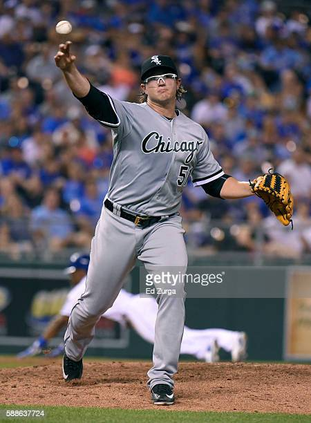 Carson Fulmer of the Chicago White Sox throws to first to get the out on Paulo Orlando of the Kansas City Royals in the sixth inning at Kauffman...
